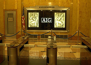 The sign in the lobby of AIG's headquarters at...